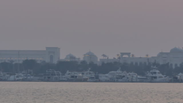 view from 18th street of the presidential palace marina at sunset, abu dhabi, united arab emirates, middle east, asia - amt stock-videos und b-roll-filmmaterial