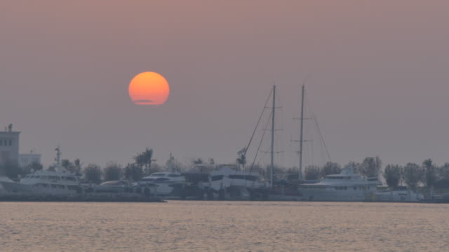 View from 18th Street of the Presidential Palace Marina at sunset, Abu Dhabi, United Arab Emirates, Middle East, Asia