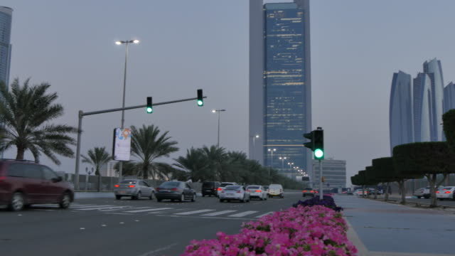 View from 18th Street of traffic and Etihad Towers at dusk, Abu Dhabi, United Arab Emirates, Middle East, Asia