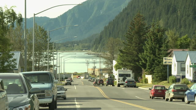 """view from 3rd avenue down past adams street to shore of resurrection bay, lots of parked cars, mountains in background. seward, kenai peninsula, alaska."" - kenai stock videos & royalty-free footage"