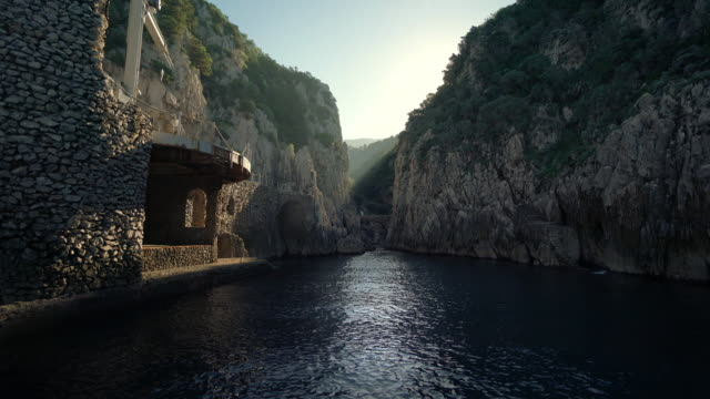 view from a boat on the coast of capri in italy - boat point of view stock videos & royalty-free footage