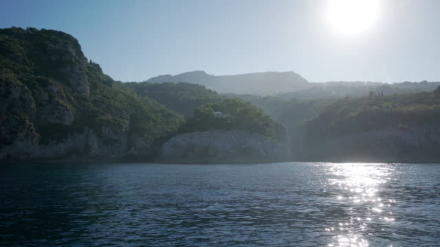 view from a boat on the coast of capri in italy - idillio video stock e b–roll