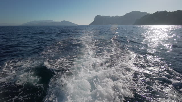 view from a boat on the coast of capri in italy - mediterranean sea stock videos & royalty-free footage