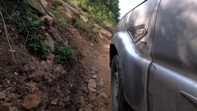 view from a car driving along a mountain road in gorkha, nepal - dirt track stock videos & royalty-free footage