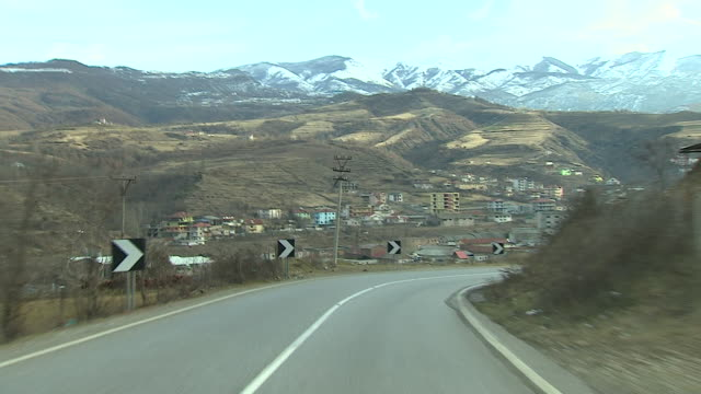 view from a car driving along a road close to the albanian capital of tirana - tirana stock videos & royalty-free footage