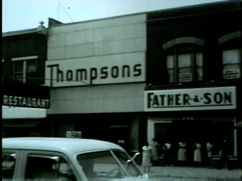 wgn view from a car driving down classic 1950's main street in gary indiana in 1954 - indiana stock videos & royalty-free footage