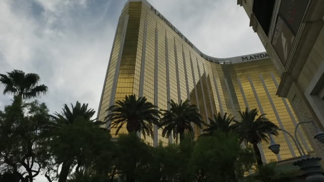 view from a car driving past the mandalay bay resort and casino in las vegas - casino stock videos & royalty-free footage