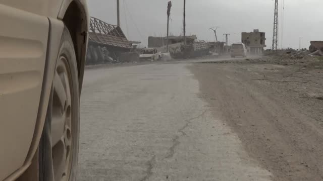 View from a car driving through Baghuz the last stronghold of Islamic State in Syria