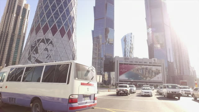 view from a car driving through doha qatar - geographical locations stock videos & royalty-free footage