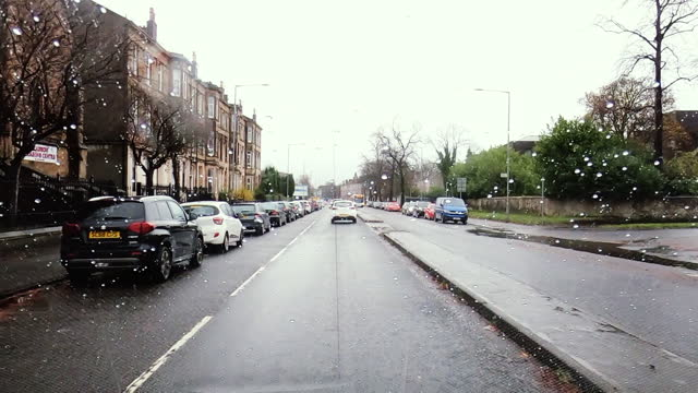 view from a car driving through glasgow - car point of view stock videos & royalty-free footage