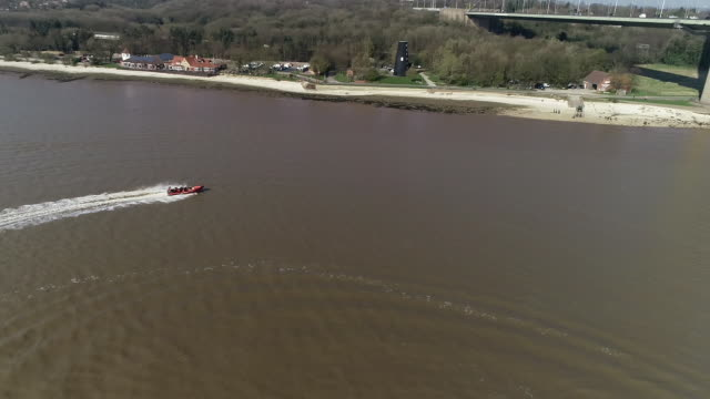 view from a drone directly above a lifeboat circling in the humber - hull stock videos & royalty-free footage