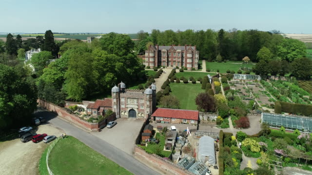 view from a drone flying over burton agnes hall - formal garden stock videos & royalty-free footage
