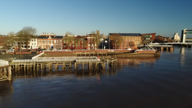 view from a drone flying over hull riverside - キングストンアポンハル点の映像素材/bロール