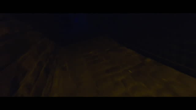 view from a drone flying through residential streets at night - mid air stock videos & royalty-free footage