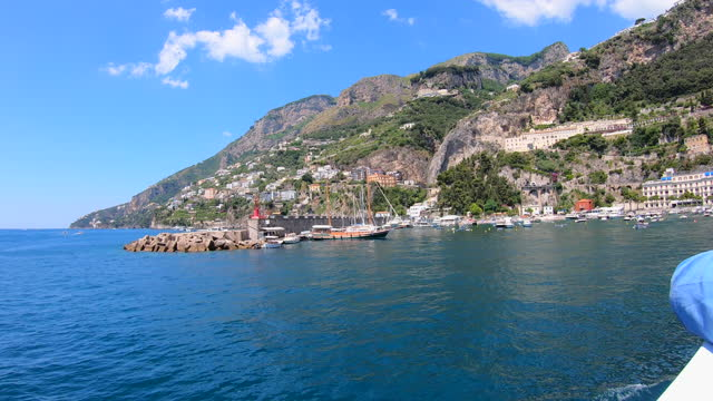 view from a ferry boat sailing to amalfi, amalfi coast, traveling in italy, europe. - time-lapse - nautical vessel video stock e b–roll