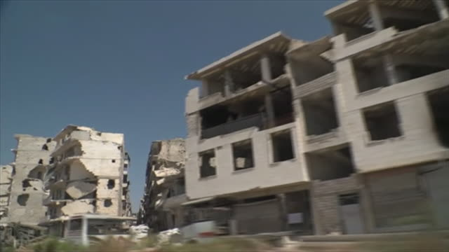 View from a moving car of damaged buildings in Aleppo Syria