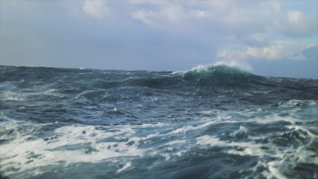 view from a sailing boat of a rough stormy sea: in the ocean during a gale - tide stock videos & royalty-free footage