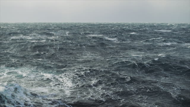 view from a sailing boat of a rough stormy sea: in the ocean during a gale - rough stock videos & royalty-free footage