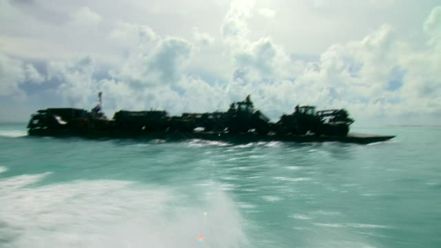 view from a speedboat of rfa mounts bay - extreme weather stock videos & royalty-free footage