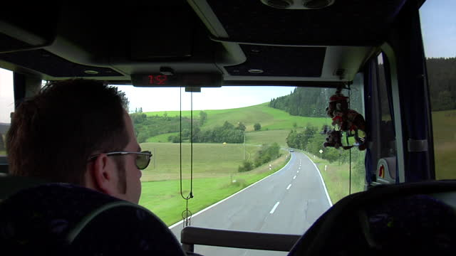 stockvideo's en b-roll-footage met view from a tour bus driving down a highway with lush green countryside in bavaria - dubbeldekker bus