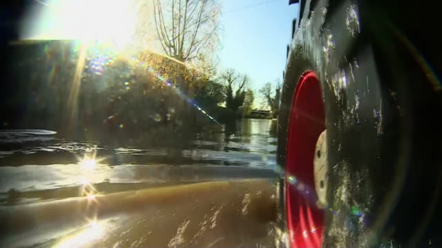 view from a tractor driving through the flooded village of fishlake - exploding stock videos & royalty-free footage