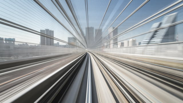 tl, ws, pov view from a train speeding through tokyo / tokyo, japan - ferrovia video stock e b–roll