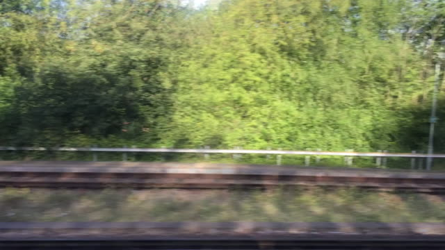 view from a train window as it moves along railway tracks - looking through window stock videos & royalty-free footage