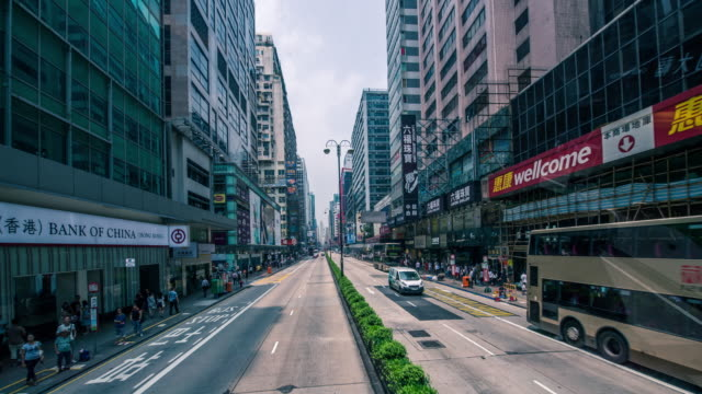 POV View from a tram speeding through the streets of day-time Hong Kong / Hong Kong, China