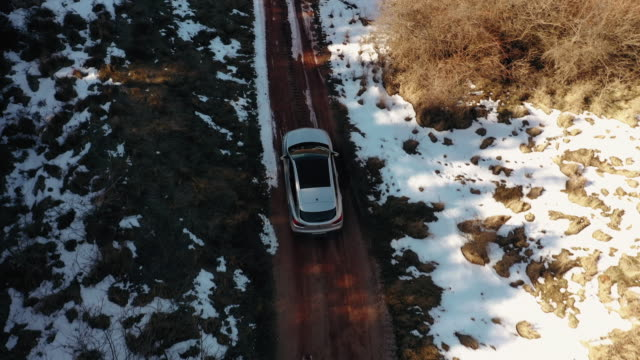 view from above of driving car on muddy country road - following stock videos & royalty-free footage