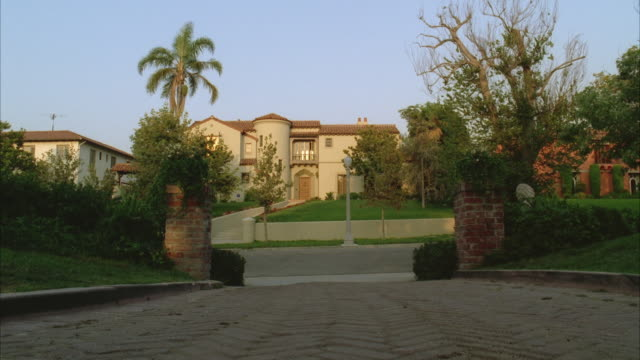WS View from across street to large 2 story Spanish style house