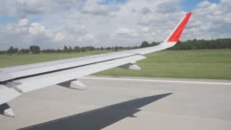View from airplane landing on airport runway. Passenger aircraft landing on runway after flight in international airport.