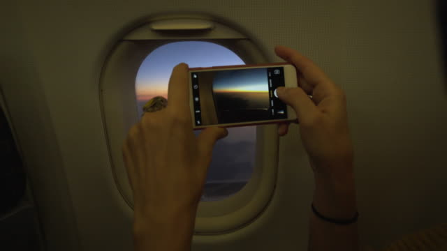 view from an airplane window - photographing stock-videos und b-roll-filmmaterial
