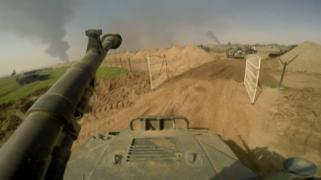view from an iraqi army tank as government troops enter western mosul for the first time since its occupation by islamic state - kampfpanzer stock-videos und b-roll-filmmaterial