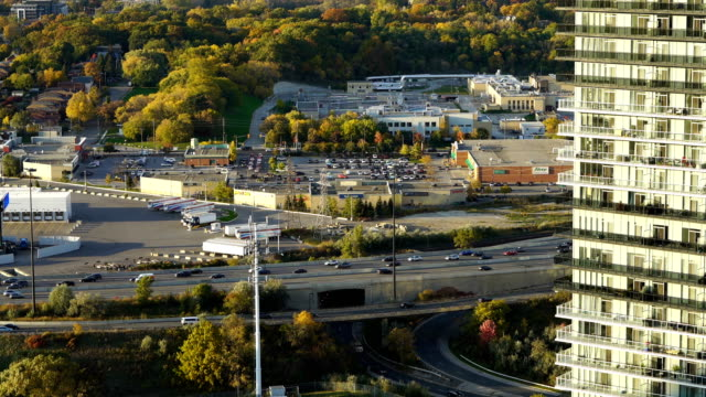 view from an overpass of the 401 highway with toronto city in background - editorial stock videos & royalty-free footage