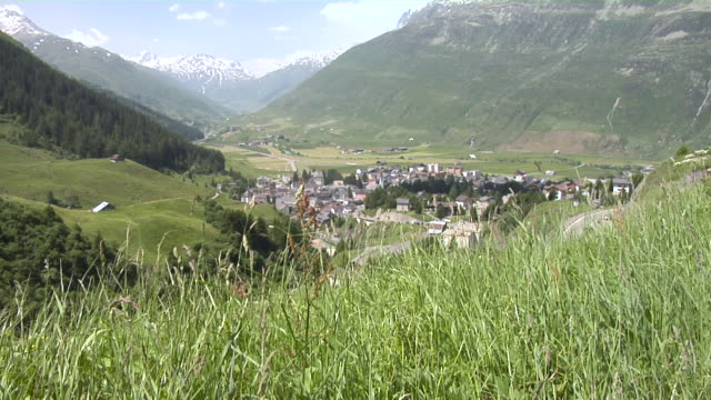 view from andermatt from the oberalp pass road - 村点の映像素材/bロール