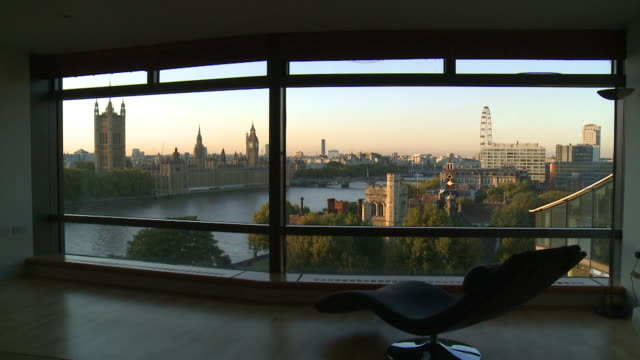 pan view from apartment to houses of parliament westminster - flat stock videos & royalty-free footage