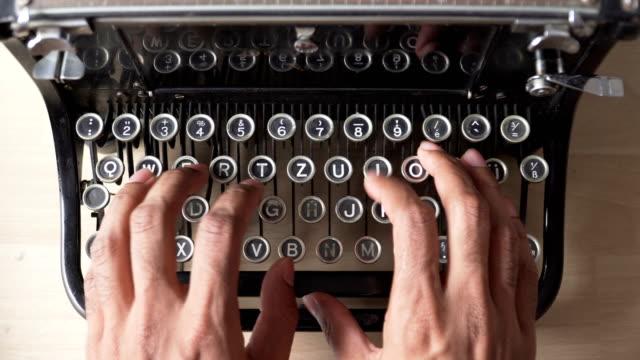 view from asian people use retro typewriter that is german keyboard - typewriter keyboard stock videos & royalty-free footage