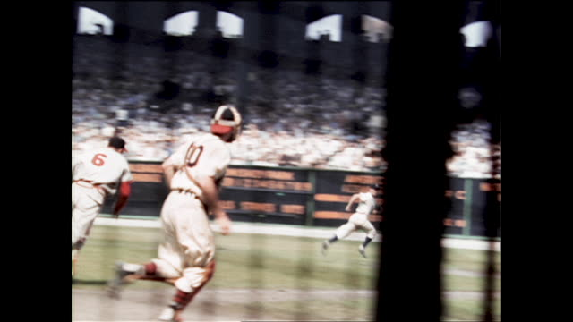 view from behind the metal fence #3 walt dropo from the boston red sox hitting #39 roy campanella as catcher and don newcombe as pitcher from the... - philadelphia phillies stock videos & royalty-free footage