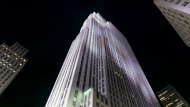 view from below of rockefeller center on december 08, 2020. fifth avenue, midtown manhattan, new york city. - directly below stock videos & royalty-free footage