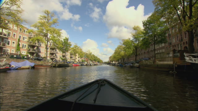 ws pov view from boat moving forward on canal, amsterdam, netherlands - boat point of view stock videos & royalty-free footage