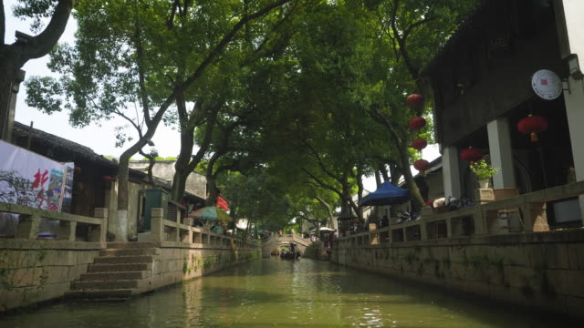pov ws view from boat moving through canal, tongli, wujiang district, suzhou, jiangsu province, china - china east asia stock videos & royalty-free footage
