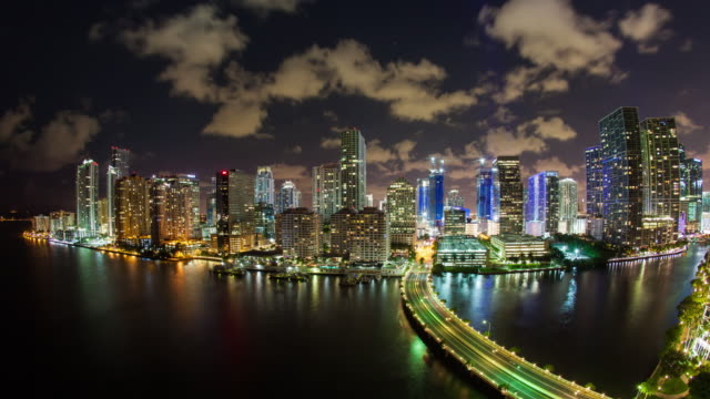view from brickell key, a small island covered in apartment towers, towards the miami skyline, miami, florida, usa - time lapse - マイアミ点の映像素材/bロール
