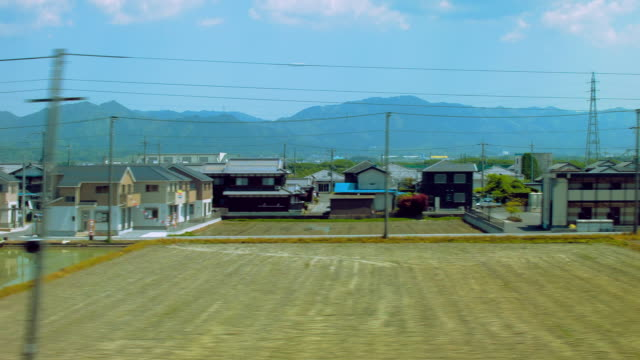 side pov,view from bullet train. japan - 農村の風景点の映像素材/bロール