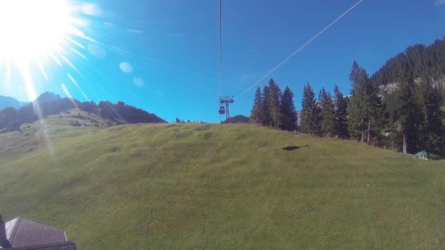 view from cable car ascending mountain ridge - overhead cable car stock videos & royalty-free footage