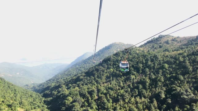 view from cable car over mountain in hong kong. - lantau stock videos and b-roll footage