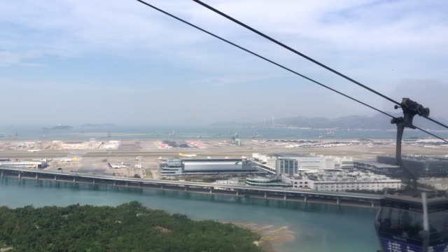 view from cable car over mountain in hong kong with airport - lantau stock videos and b-roll footage