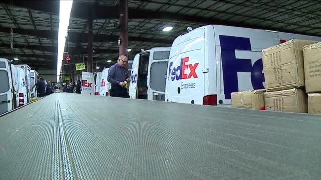 view from conveyor belt of packages loaded into truck in a fedex warehouse, then trucks leaving warehouse in indianapolis on dec. 13, 2016. - conveyor belt stock videos & royalty-free footage