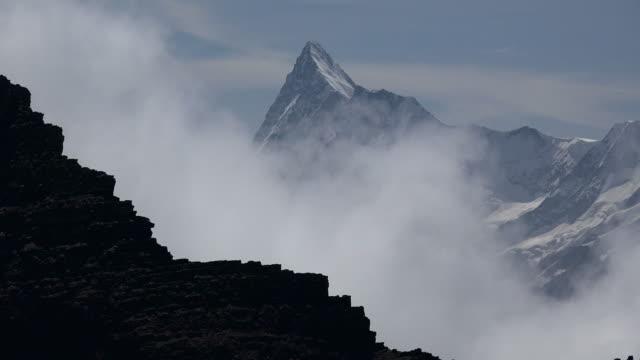 view from faulhorn to schreckhorn, grindelwald, bernese alps, switzerland - berner alpen stock-videos und b-roll-filmmaterial