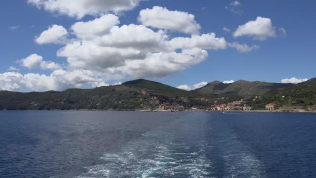 pov/ tu/ view from ferry leaves rio marina - island of elba stock videos & royalty-free footage