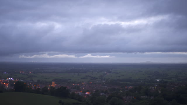 a view from glastonbury tor of glastonbury town and the tower of st john the baptist's church. - glastonbury tor stock videos & royalty-free footage